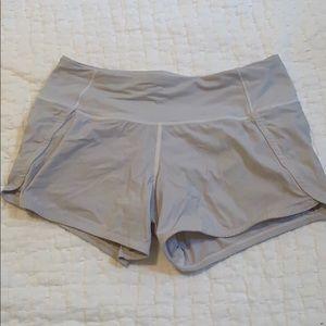White Lululemon run times shorts